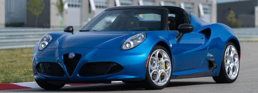 Blue 2020 Alfa Romeo 4C Spider on track from exterior front drivers side