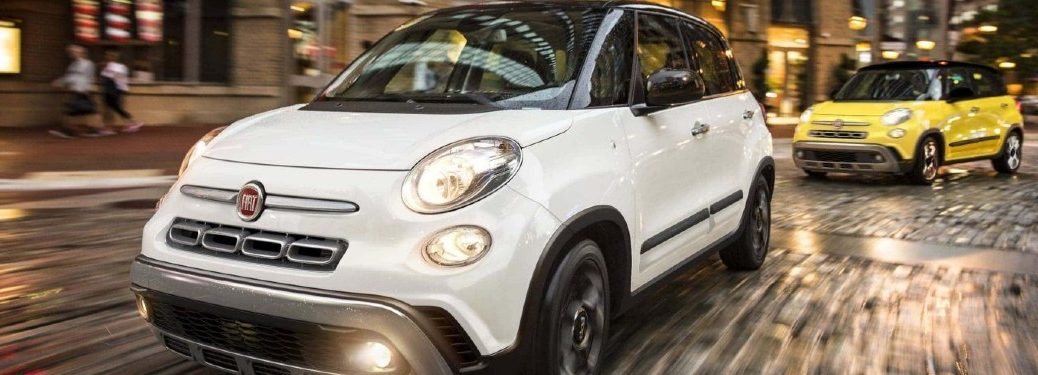 Two 2020 FIAT 500L cars driving on a road