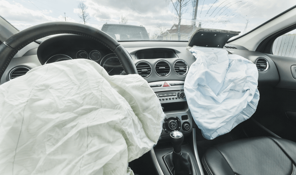 two deployed air bags in a car