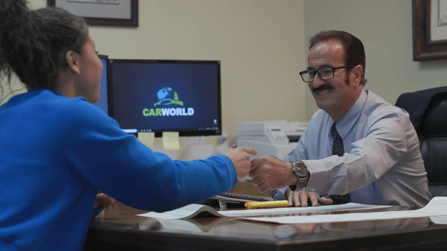 Car World Sales Rep With Customer