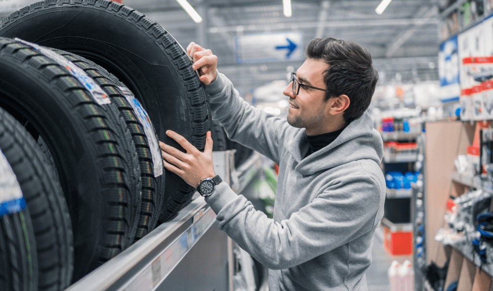man-buying-tires-in-store