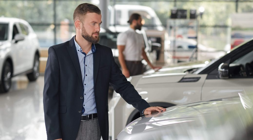 Men-Looking-For-Vehicles-To-Buy-In-Car-Dealership