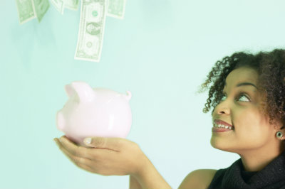 woman with piggy bank showered with money