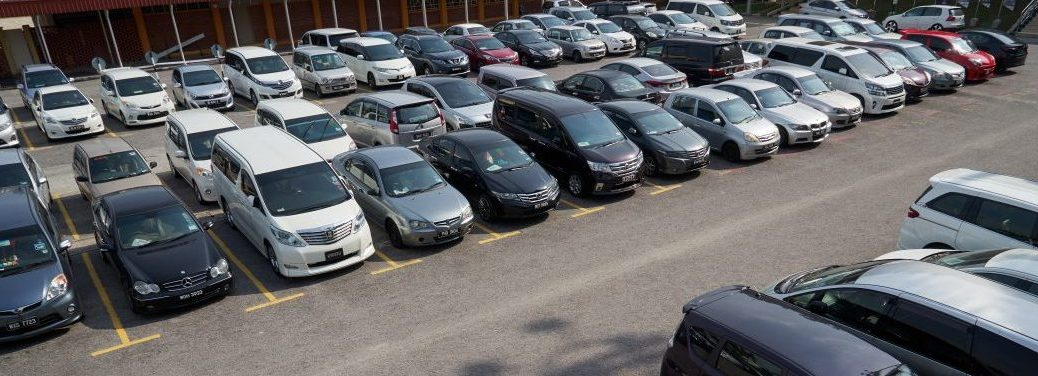 car lot with various used vehicles for sale