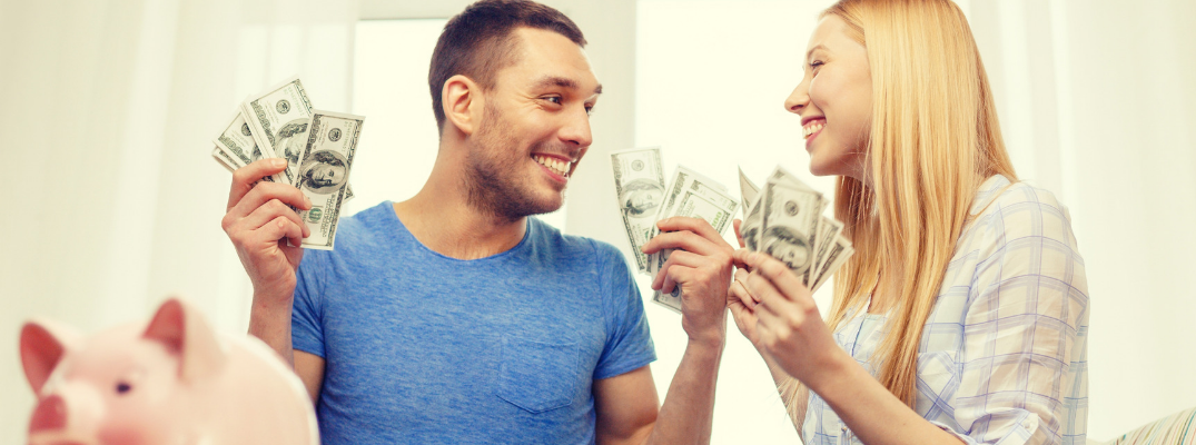 man and woman holding cash