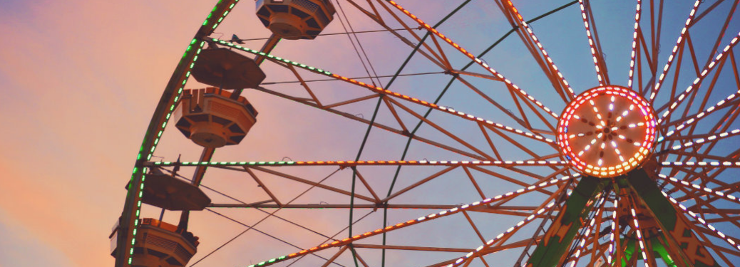 close up of ferris wheel at dusk