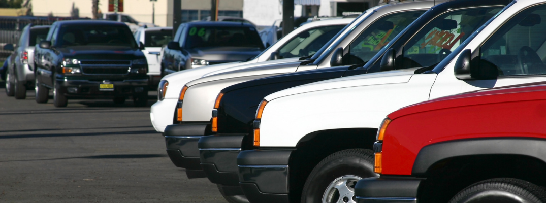 front ends of various suvs at used car dealership lot