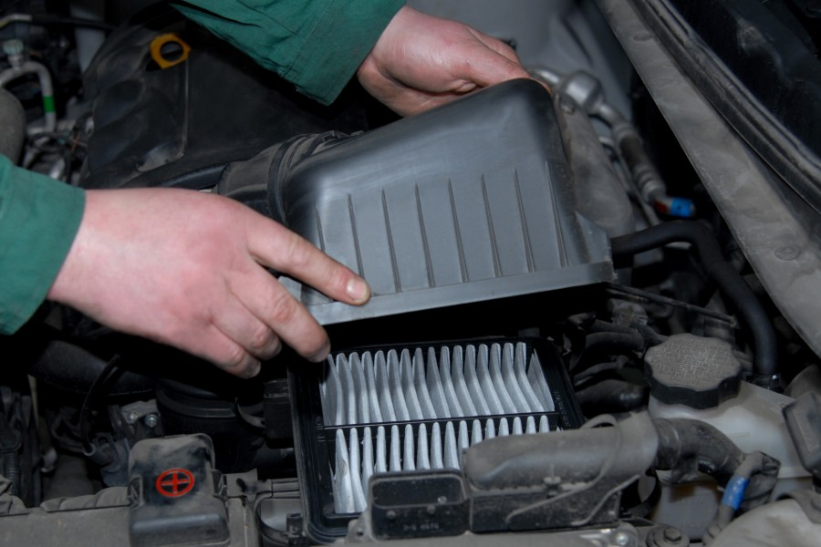 Person Opening and Checking their Air Filter in their Car
