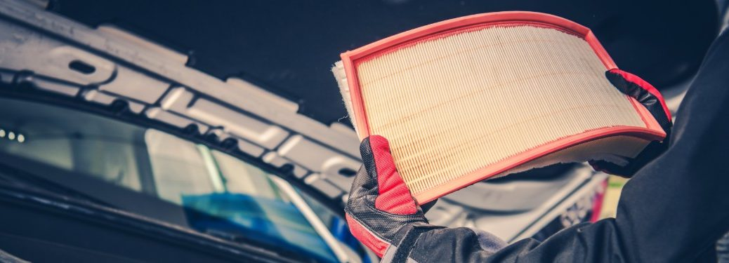 Mechanic Checking and Replacing the Air Filter in a Car