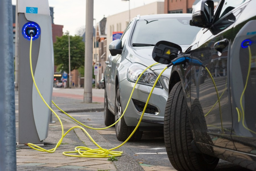 Electric Vehicles Parked and Plugged into Charging Stations