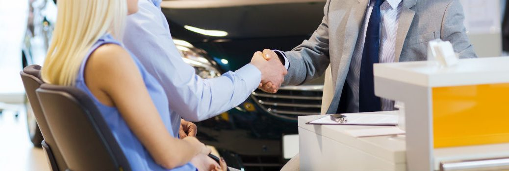 Handshake After Vehicle Trade In Between Couple and Salesman