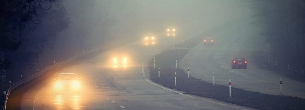 Cars driving in foggy weather