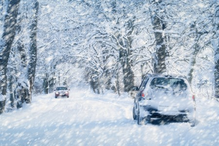 Cars driving in the middle of a blizzard