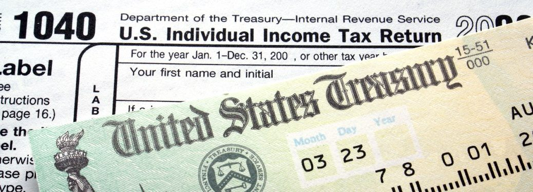 Close up of a tax form and a check from the US government