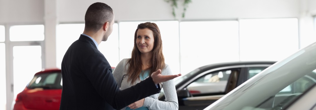Car dealer talking with a woman