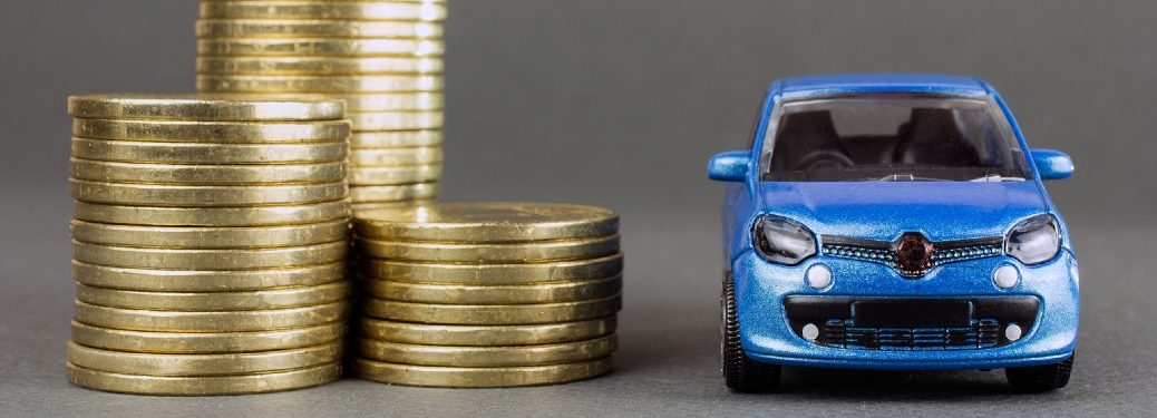 Blue toy car next to stacks of gold coins