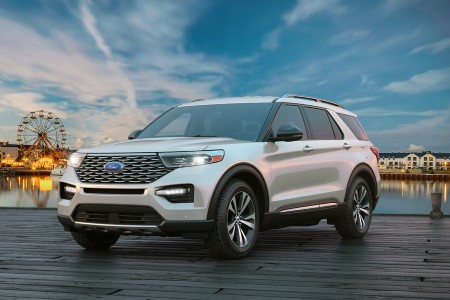 Front driver angle of a white 2020 Ford Explorer parked on a pier