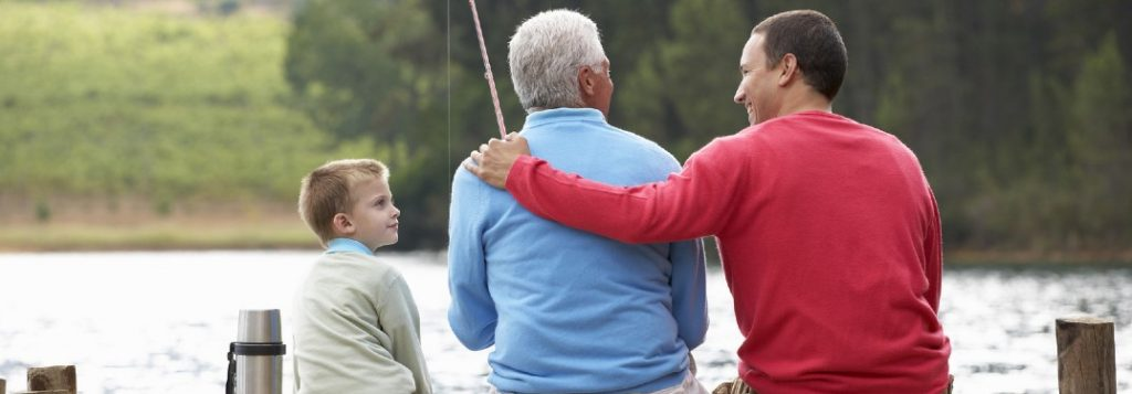 Father, son, and grandfather fishing on a pier