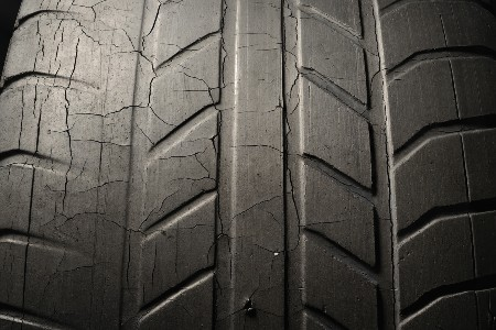 Close up of a car tire with cracks