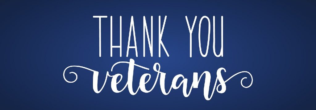 """Text saying """"Thank You Veterans"""" on a blue background"""