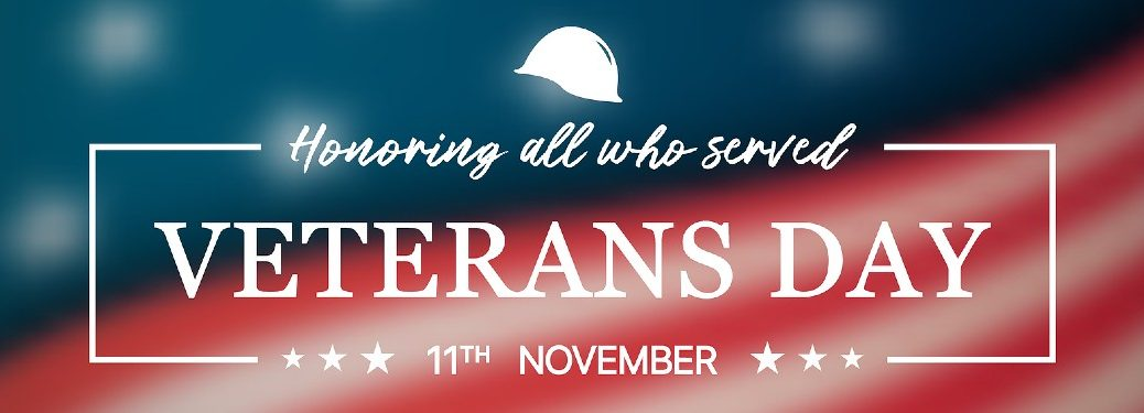 "Text saying ""Honoring all who served: Veteran's Day; November 11th"" with an American flag in the background"