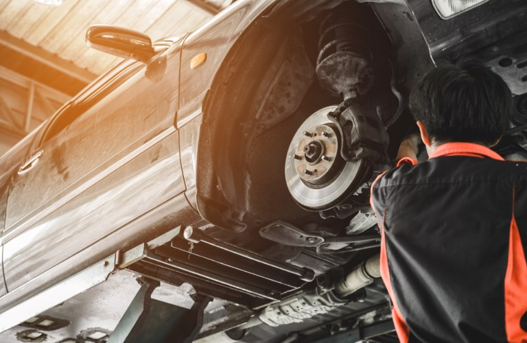 Mechanic replacing the brakes on a car