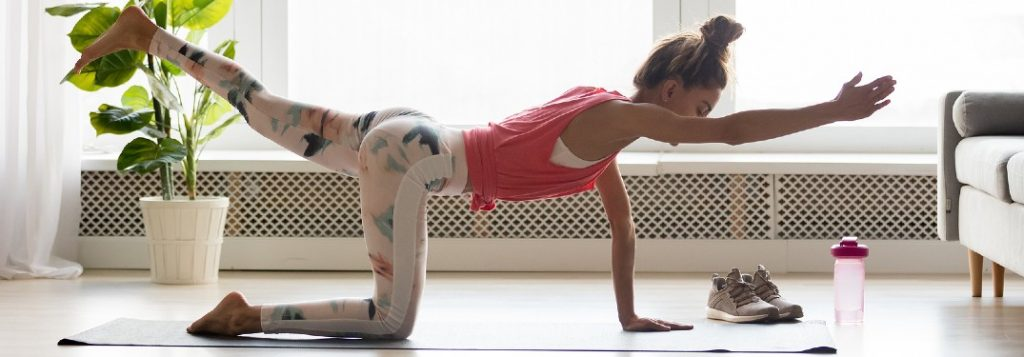 Young woman doing yoga at home