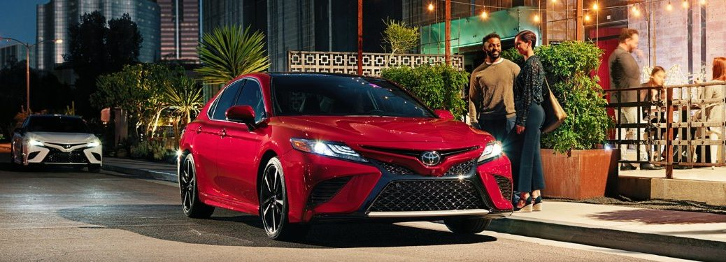 Front passenger angle of a red 2021 Toyota Camry