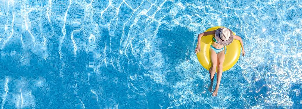 Woman floating in a tube in a swimming pool