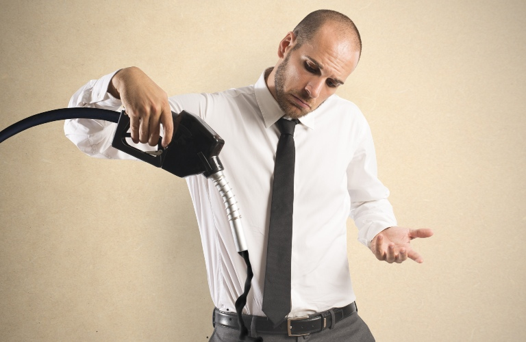 Concept of businessman with pump and lack of fuel