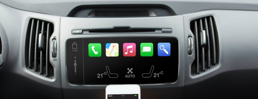 Vehicle center touchscreen visible with smartphone in frame