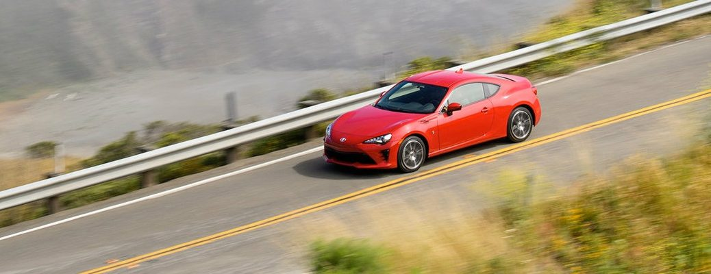 High shot of 2018 Toyota 86 driving on mountainous road