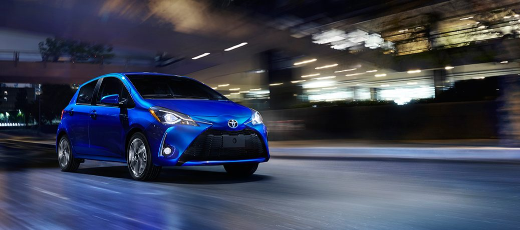 Blue 2018 Toyota Yaris driving down the highway