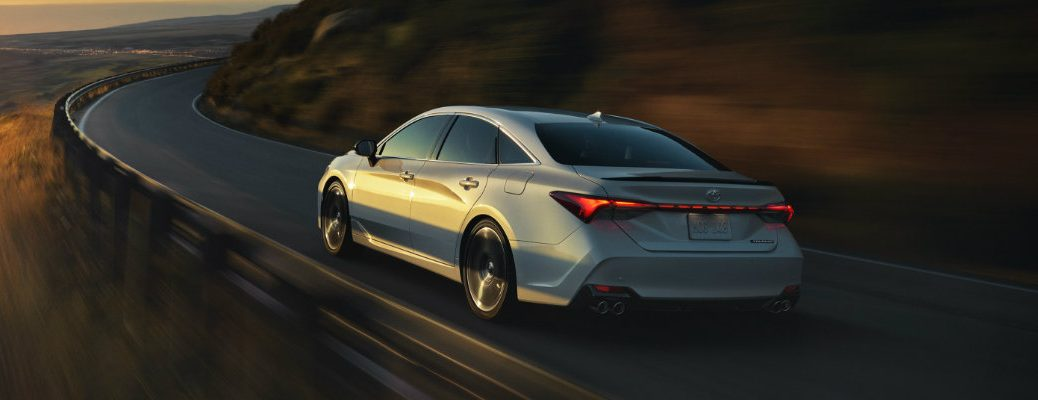 Silver 2019 Toyota Avalon driving on highway at dusk