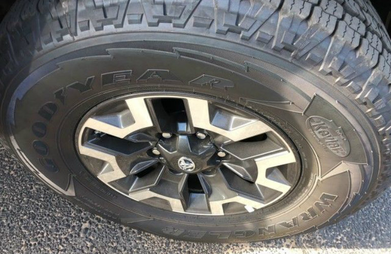 Isolated view of Toyota Tacoma tire at Alexander Toyota