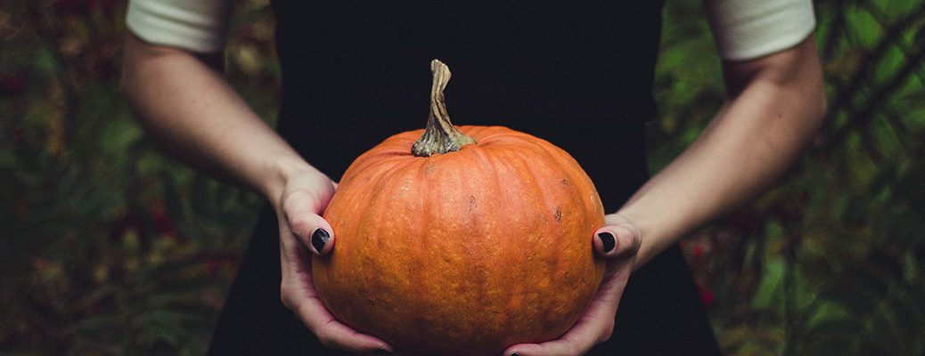 Young girl holding pumpkin in Halloween image