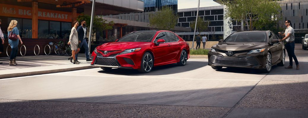 Two 2019 Toyota Camry models parked in daytime