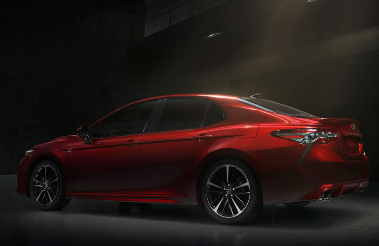 Profile view of red 2019 Toyota Camry