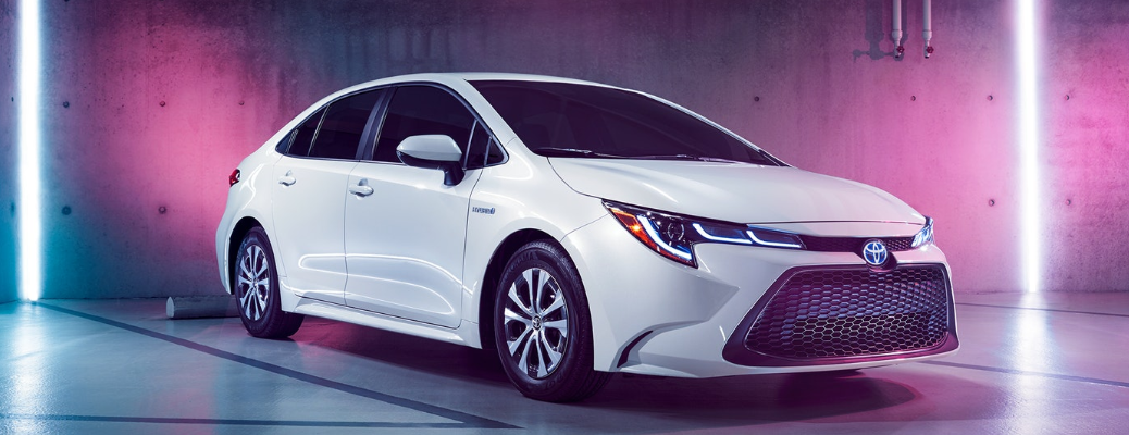 White 2020 Toyota Corolla Hybrid parked in room surrounded by lights