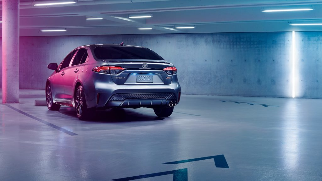 Rear view of 2020 Toyota Corolla Hybrid driving in garage