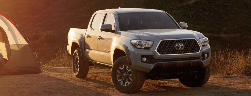2019 Toyota Tacoma parked with camping tent in frame