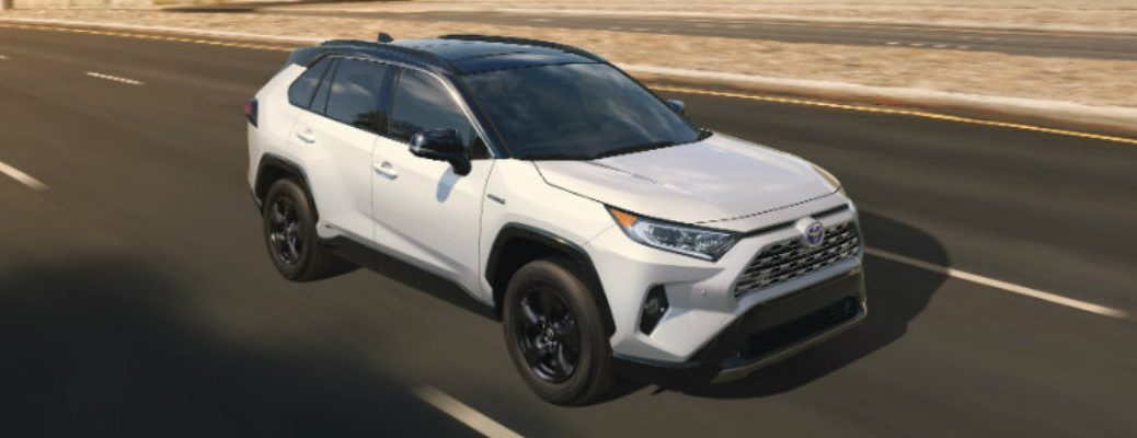 White 2019 Toyota RAV4 driving on desert road