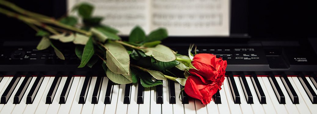 Roses laid out over piano in restaurant for Valentine's Day