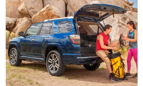 2019 Toyota 4Runner with people resting in the trunk