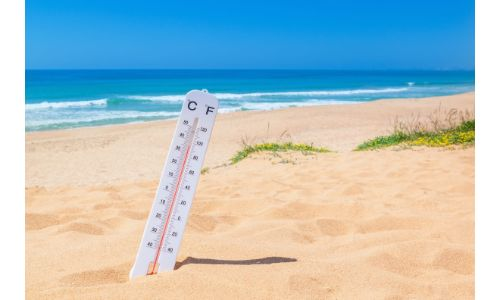 Thermometer on the beach to show it is hot