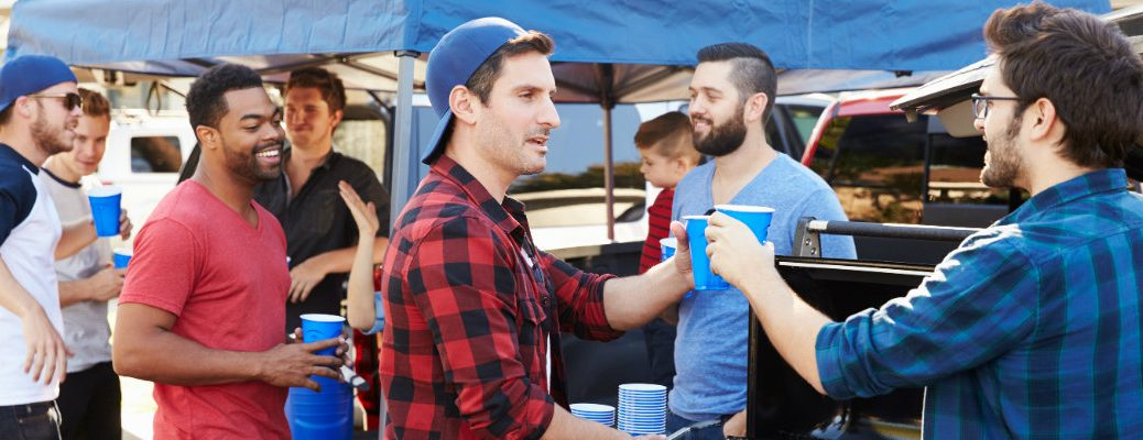 A group of dudes at a tailgate party