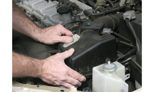 Person shifting something around in an engine