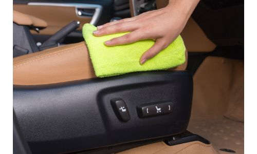 Leather center console being wiped down