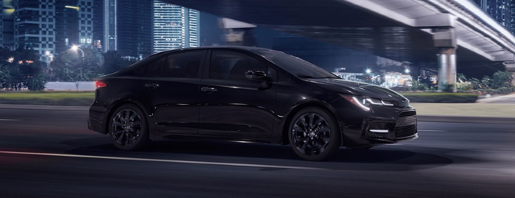 2021 Toyota Corolla driving in the city at night