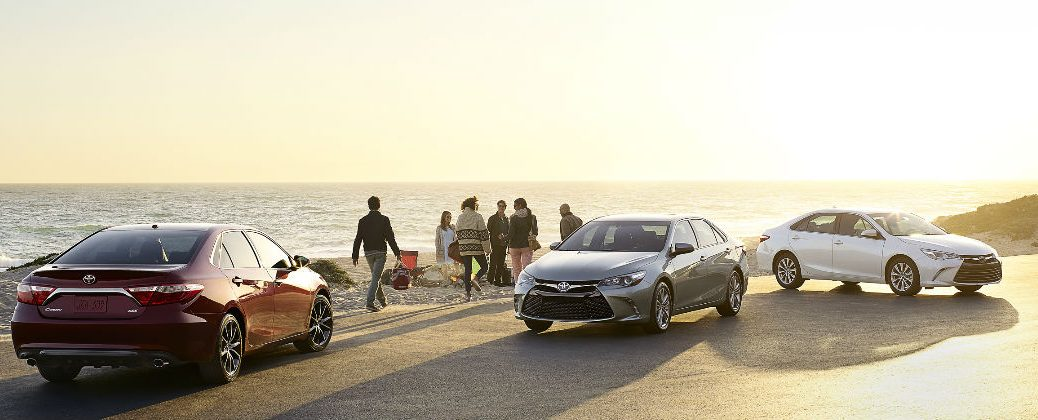 Three 2016 Toyota Camry Models at the Beach-Camry XSE-Camry Hybrid SE-Camry XLE